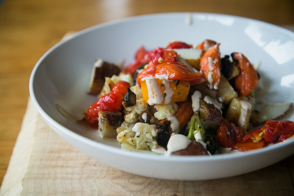 tahini garlic sauce with roasted vegetables